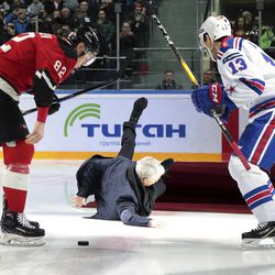 Former Manchester United coach Jose Mourinho, center, falls down after making the first puck drop at Monday's Kontinental Hockey League game between Avangard Omsk and SKA St. Petersburg in Moscow, Russia, Monday, Feb. 4, 2019. Former Manchester United coach has ceremonially opened an ice hockey game in Russia _ and promptly fallen on the ice. Two-time Stanley Cup winner Pavel Datsyuk of SKA St. Petersburg is on the right, Yevgeni Medvedev of Avangard Omsk is on the left. (AP Photo/Dmitry Golubovich)