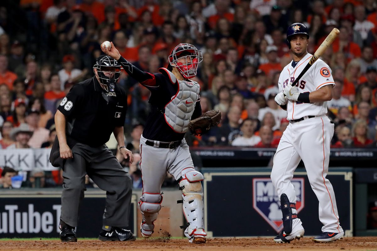 Kurt Suzuki of the Washington Nationals throws down to first base against the Houston Astros during the fifth inning in Game Two of the 2019 World Series at Minute Maid Park on October 23, 2019 in Houston, Texas.