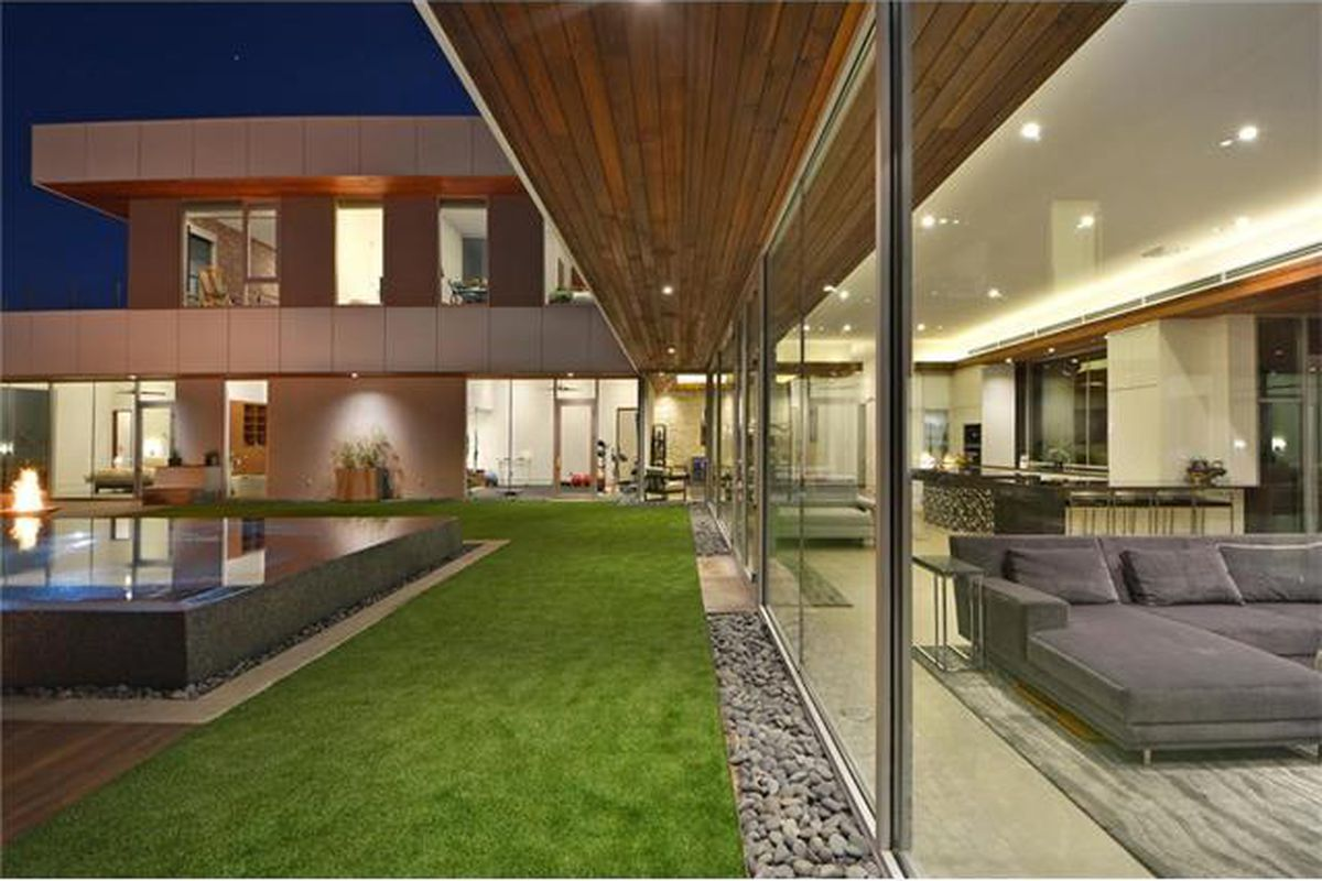 large contemporary house and pool at night