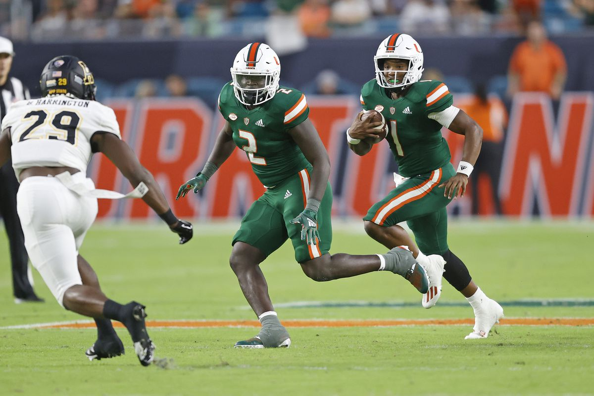 Donald Chaney, Jr. #2 leads D'Eriq King #1 of the Miami Hurricanes as he runs with the ball against the Appalachian State Mountaineers on September 11, 2021 at Hard Rock Stadium in Miami Gardens, Florida.