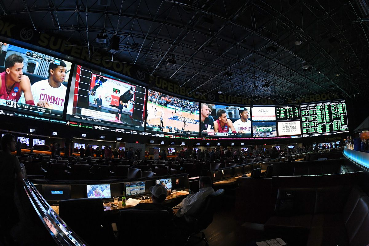 Guests attend a viewing party for the NCAA Men's College Basketball Tournament inside the 25,000-square-foot Race & Sports SuperBook at the Westgate Las Vegas Resort & Casino on March 15, 2018 in Las Vegas, Nevada.