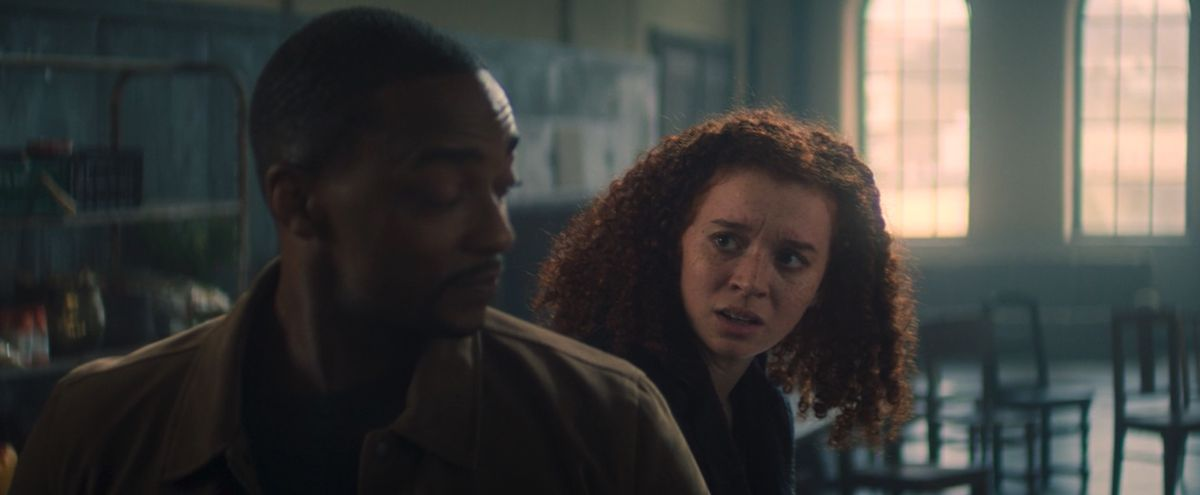 Karli sits in shock next to Sam WIlson in Falcon and the Winter Soldier