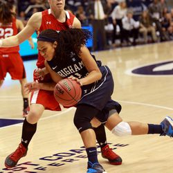 BYU's Xojian Harry moves around Utah's Michelle Plouffe during a women's basketball game at the Marriott Center in Provo on Saturday, Dec. 14, 2013. Utah won in double overtime 82-74.