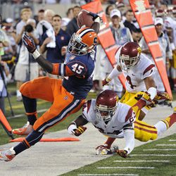 Syracuse running back Jerome Smith (45) is knocked out of bounds by Southern California safety Demetrius Wright and cornerback Torin Harris (4) during the third quarter of an NCAA college football game Saturday, Sept. 8, 2012, in East Rutherford, N.J. USC defeated Syracuse 42-29.