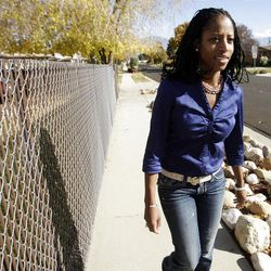 Candidate Mia Love walks door to door in West Valley City on Friday, Nov. 2, 2012, talking to residents about her campaign.