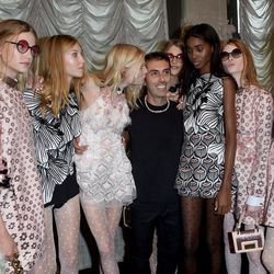 The designer with models backstage. Photo: Getty.