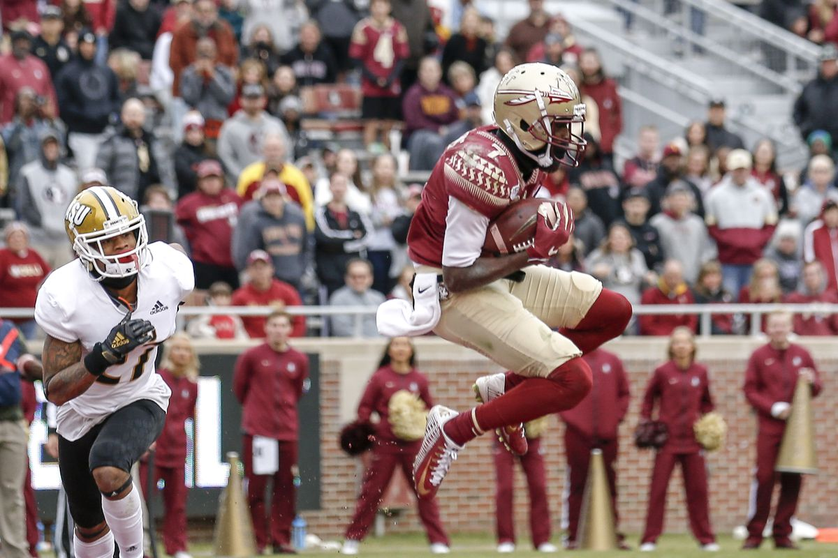 Wide Receiver D.J. Matthews of the Florida State Seminoles catches a touchdown pass over Safety Aaron Pope of the Alabama State Hornets during the game at Doak Campbell Stadium on Bobby Bowden Field on November 16, 2019 in Tallahassee, Florida.