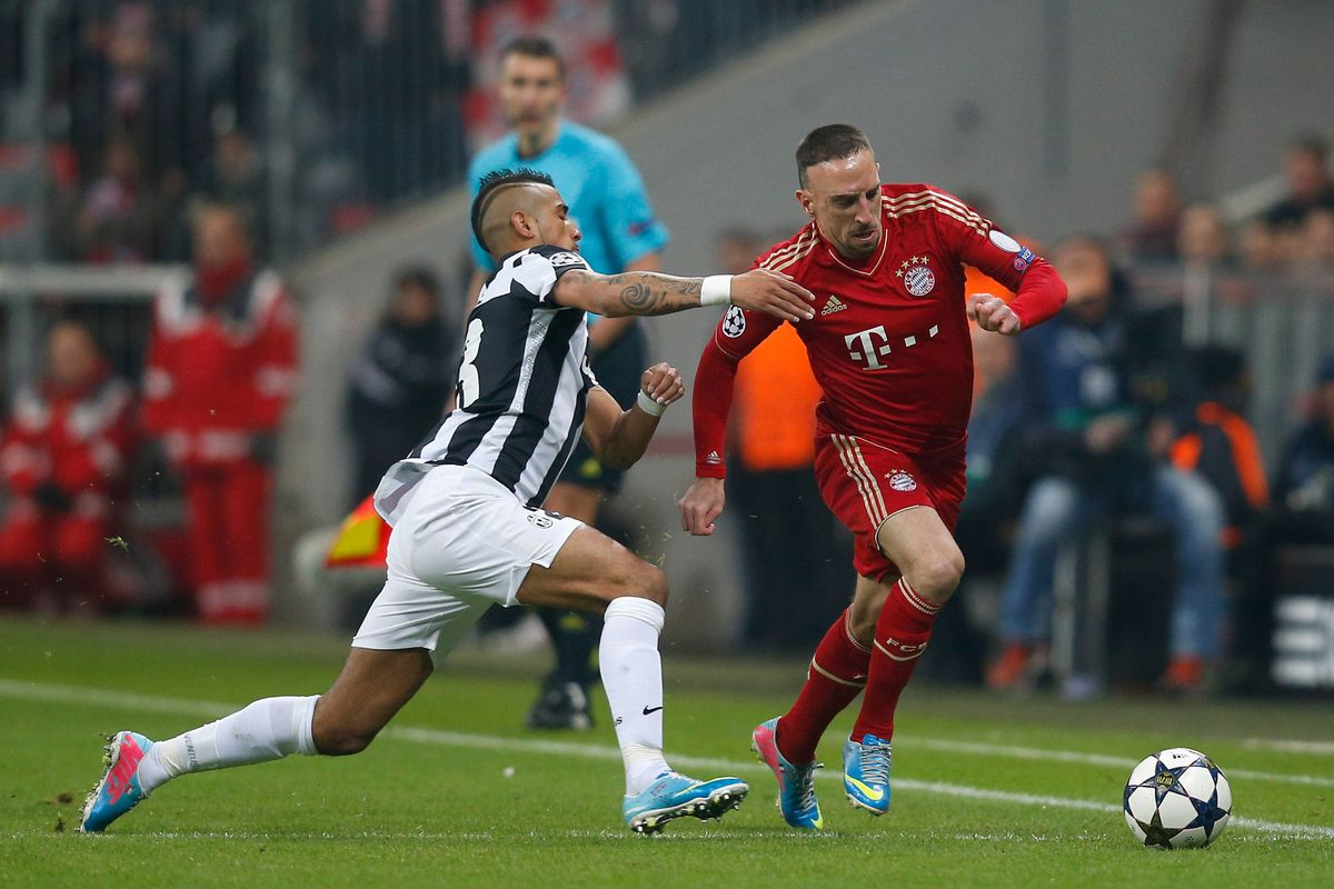 Franck Ribery and Arturo Vidal contest in one of the many battles between the two during the first leg.