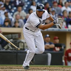 San Diego Padres' Kyle Blanks tosses his bat as he flies out to right with two runners on-base to end the fourth inning threat against the Arizona Diamondbacks in a baseball game on Wednesday, April 11, 2012, in San Diego.