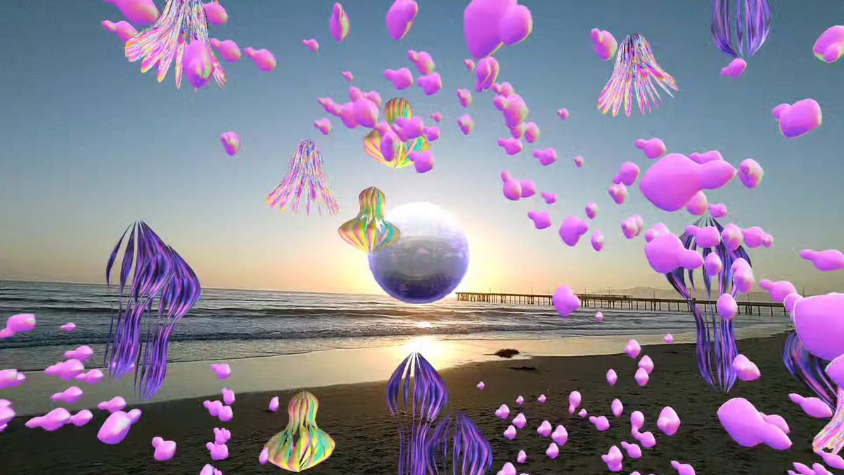 An image showing sea creatures like jelly fish floating through the air above the beach at sunset. It's a first person view through the new Spectacles.