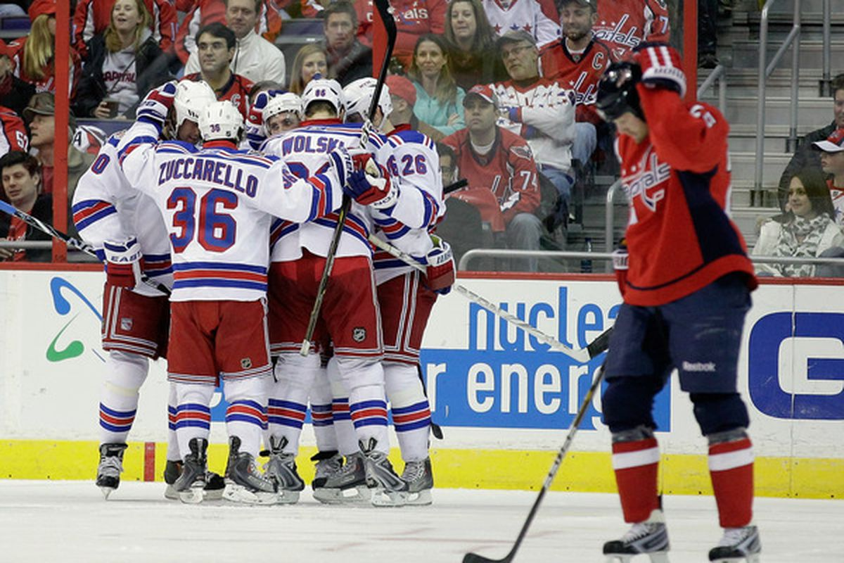 WASHINGTON DC - FEBRUARY 25:  Members of the New York Rangers celebrate scoring a goal against the Washington Capitals at the Verizon Center on February 25 2011 in Washington DC.  (Photo by Rob Carr/Getty Images)