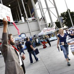 Christian Versteeg, dressed as Brigham Young holds up a sign in the north west entrance to the field as BYU and Utah prepare to play Saturday, Sept. 17, 2011 at Lavell Edwards Stadium.