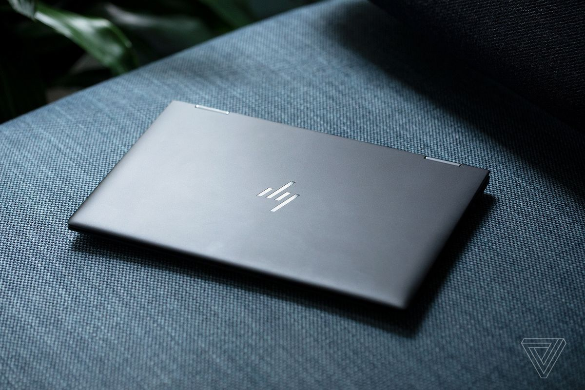 The HP Elite Dragonfly Max closed seen from above on a fabric bench.