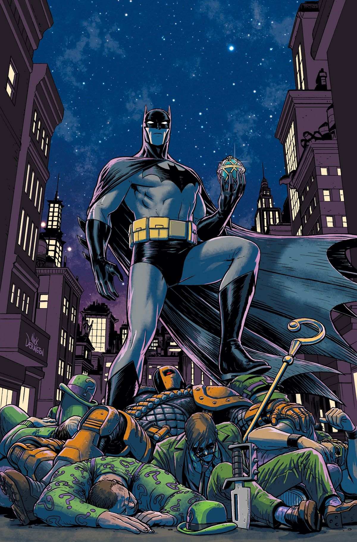 Batman stands over a pile of unconscious Riddler doppelgängers and Deathstroke, holding a Fabergé egg, against a starry sky. His costume is black and grey, with a grey bat symbol with no oval.