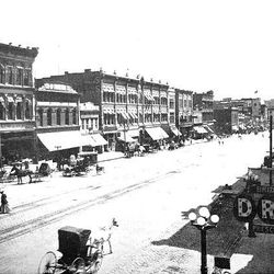 Main Street 1909 looking south. ZCMI is on the left. At the end of the street are the newly completed Boston and Newhouse buildings.