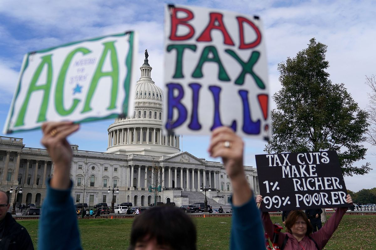 WASHINGTON, DC - NOVEMBER 15:  Demonstrators join a rally against the proposed Republican tax reform legislation on the east side of the U.S. Capitol November 15, 2017 in Washington, DC. The rally was organized by a large group of liberal organizations, including MoveOn.org, National Education Association, Patriotic Millionaires, Stand Up America, Our Revolution, Americans for Tax Fairness Action Fund, Tax March, the Center for American Progress Action Fund, Communications Workers of America, Indivisible, Little Lobbyists, Main Street Alliance and VoteVets.  (Photo by Chip Somodevilla/Getty Images)