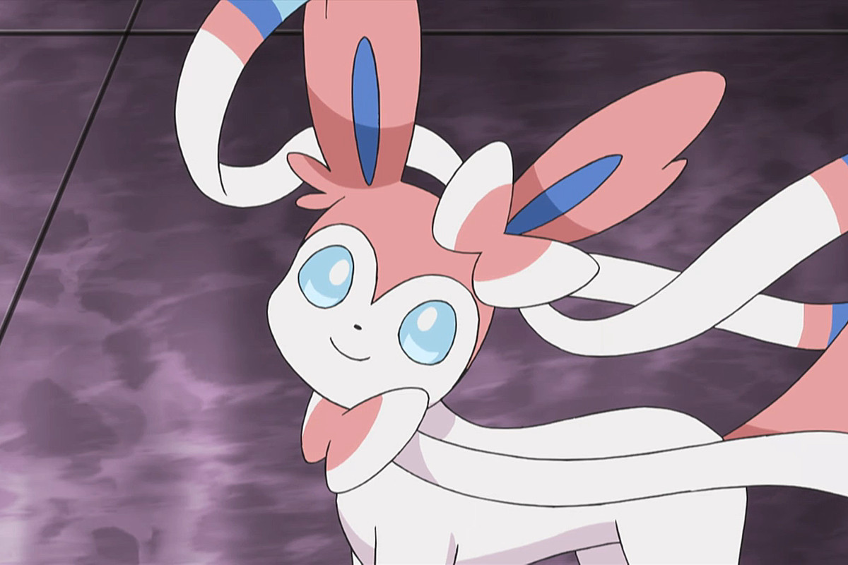 Sylveon looks up at the viewer in the anime