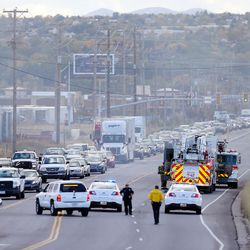 Traffic stacks up along 5600 West as West Valley City firefighters respond to a junkyard fire on Monday, Oct. 17, 2016.