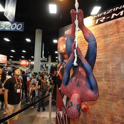 Fans get a look at an Amazing Spider-Man exhibit on the last day of the Comic-Con International 2011 convention held in San Diego Sunday, July 24, 2011. The annual comic book and popular arts convention attracts over 100,000 people and runs through Sunday July 24.