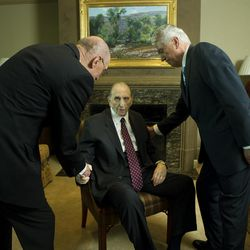 President Thomas S. Monson shakes hands with his counselors, President Henry B. Eyring and President Dieter F. Uchtdorf, on Tuesday, Aug. 15, 2017, in his Salt Lake City apartment as he neared his 90th birthday on Aug. 21, 2017.