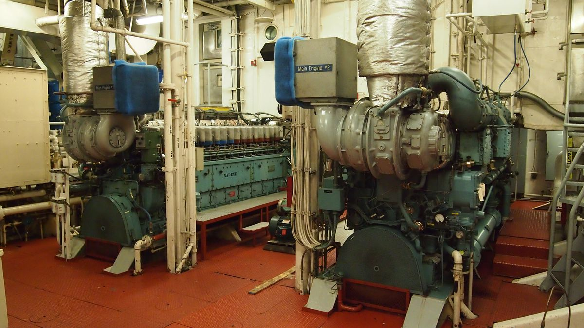 Two turquoise-colored ship engines side by side. Their names are Rose (right) and Nadene (left).