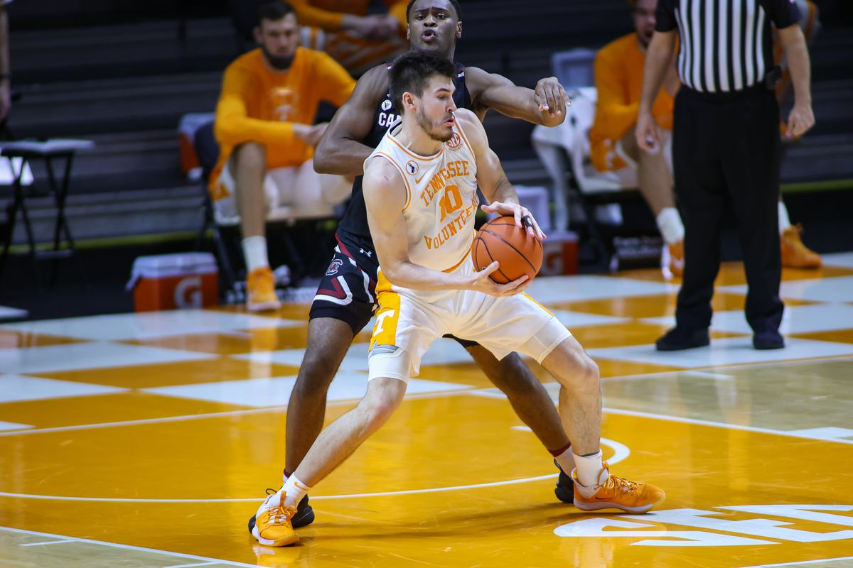 Tennessee Volunteers forward John Fulkerson controls the ball against South Carolina Gamecocks forward Wildens Leveque during the second half at Thompson-Boling Arena.