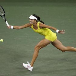 Ana Ivanovic, of Serbia, returns to Serena Williams, of the United States, during a quarterfinal at the U.S. Open tennis tournament, Wednesday, Sept. 5, 2012, in New York. (AP Photo/Charles Krupa)