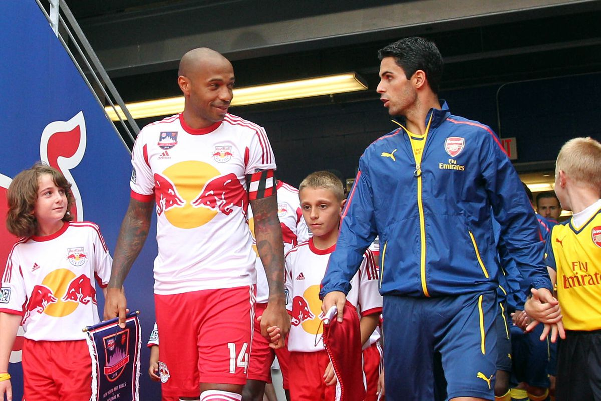 a pair of Arsenal legends share a moment