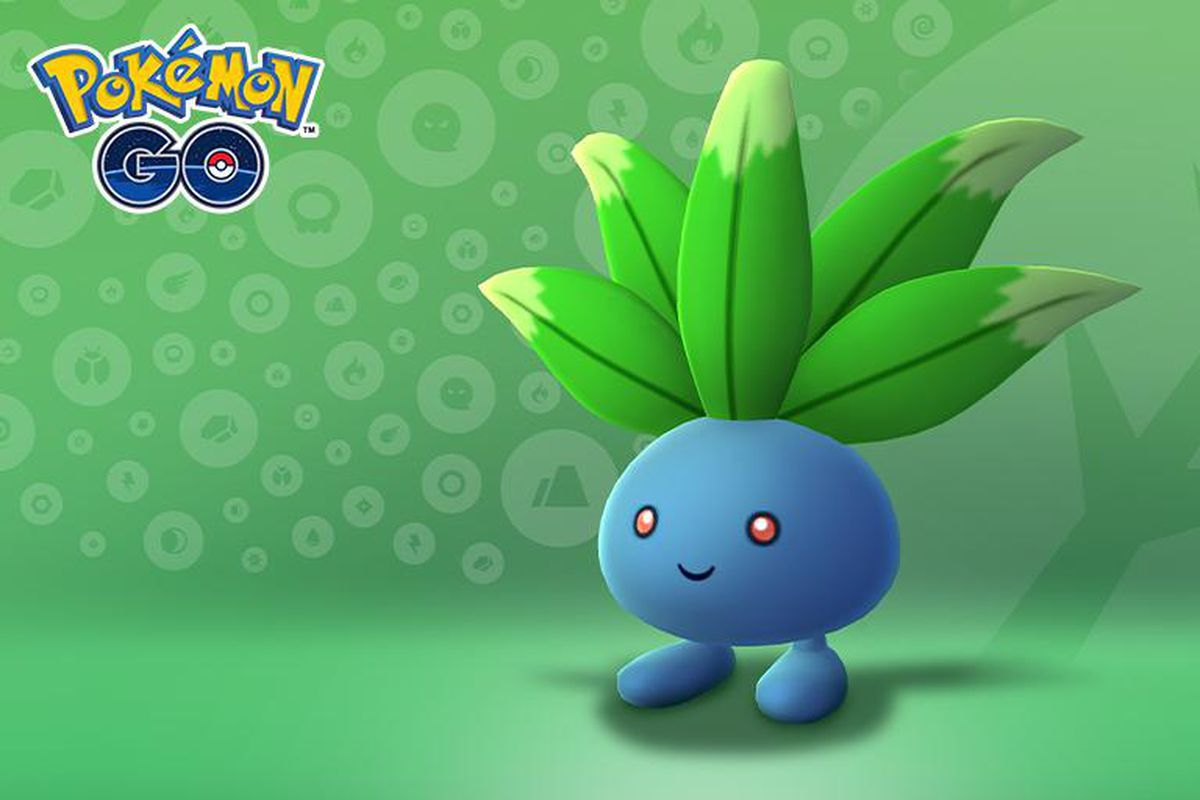 An Oddish stands with a cute smile in front of a green leafy background