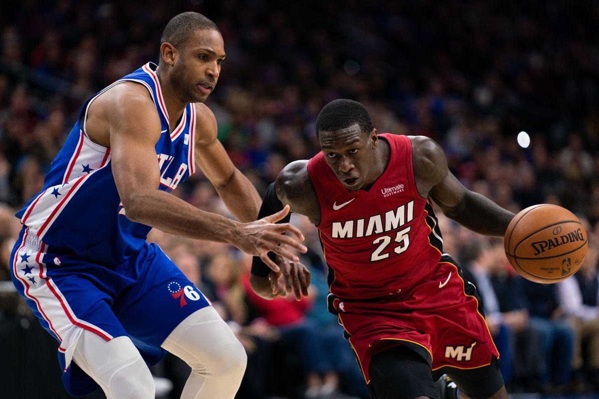 Miami Heat guard Kendrick Nunn drives the ball against Philadelphia 76ers center Al Horford during the second quarter at Wells Fargo Center.