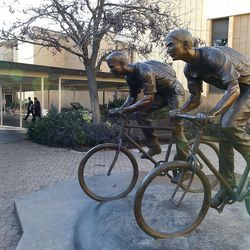 Missionaries walk by a bronze sculpture on missionaries on bikes on the week of the commemoration of 50 years of language training at the Missionary Training Center for LDS missionaries on Tuesday, Jan. 31, 2012, in Provo, Utah.