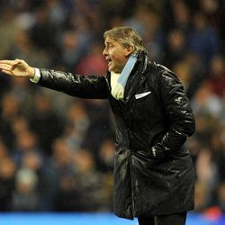 Manchester City's manager Roberto Mancini during their English League Cup third round match at the Etihad Stadium in Manchester, England, Tuesday Sept. 25, 2012.