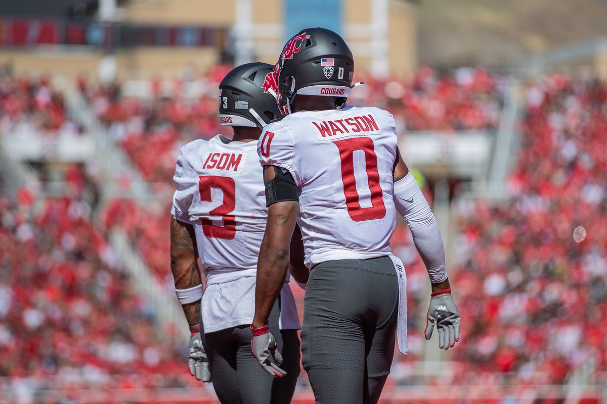 SALT LAKE CITY, UT - SEPTEMBER 25: Washington State defensive backs Daniel Isom (3) and Jaylen Watson (0) walk back to the huddle during the second half of a PAC 12 conference matchup between the Utah Utes and the Washington State Cougars on September 25, 2021, at Rice-Eccles Stadium in Salt Lake City, UT.
