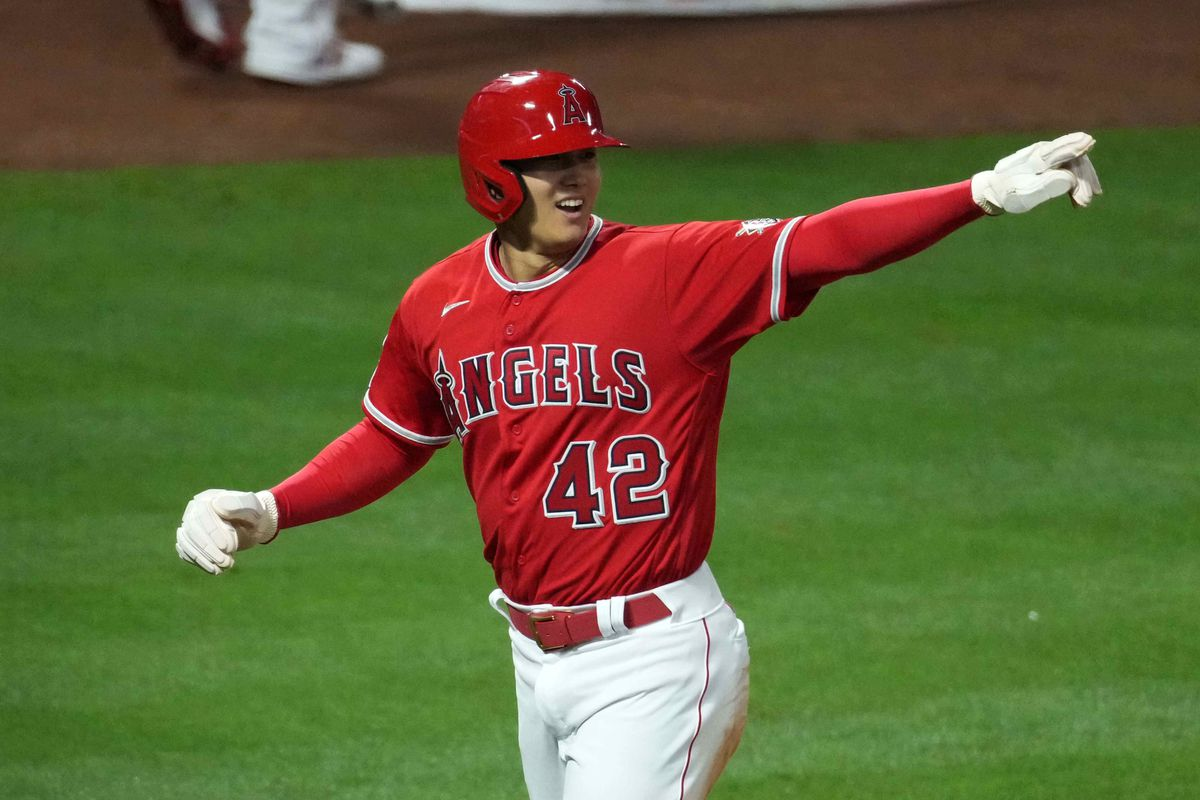 Los Angeles Angels designated hitter Shohei Ohtani celebrates after scoring in the sixth inning against the Minnesota Twins at Angel Stadium.