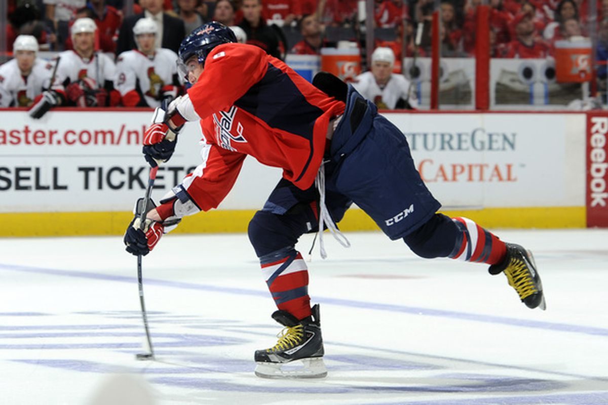 WASHINGTON - OCTOBER 11:  Alex Ovechkin #8 of the Washington Capitals shoots the puck against the Ottawa Senators at the Verizon Center on October 11, 2010 in Washington, DC. The Capitals won the game 3-2. (Photo by Greg Fiume/Getty Images)