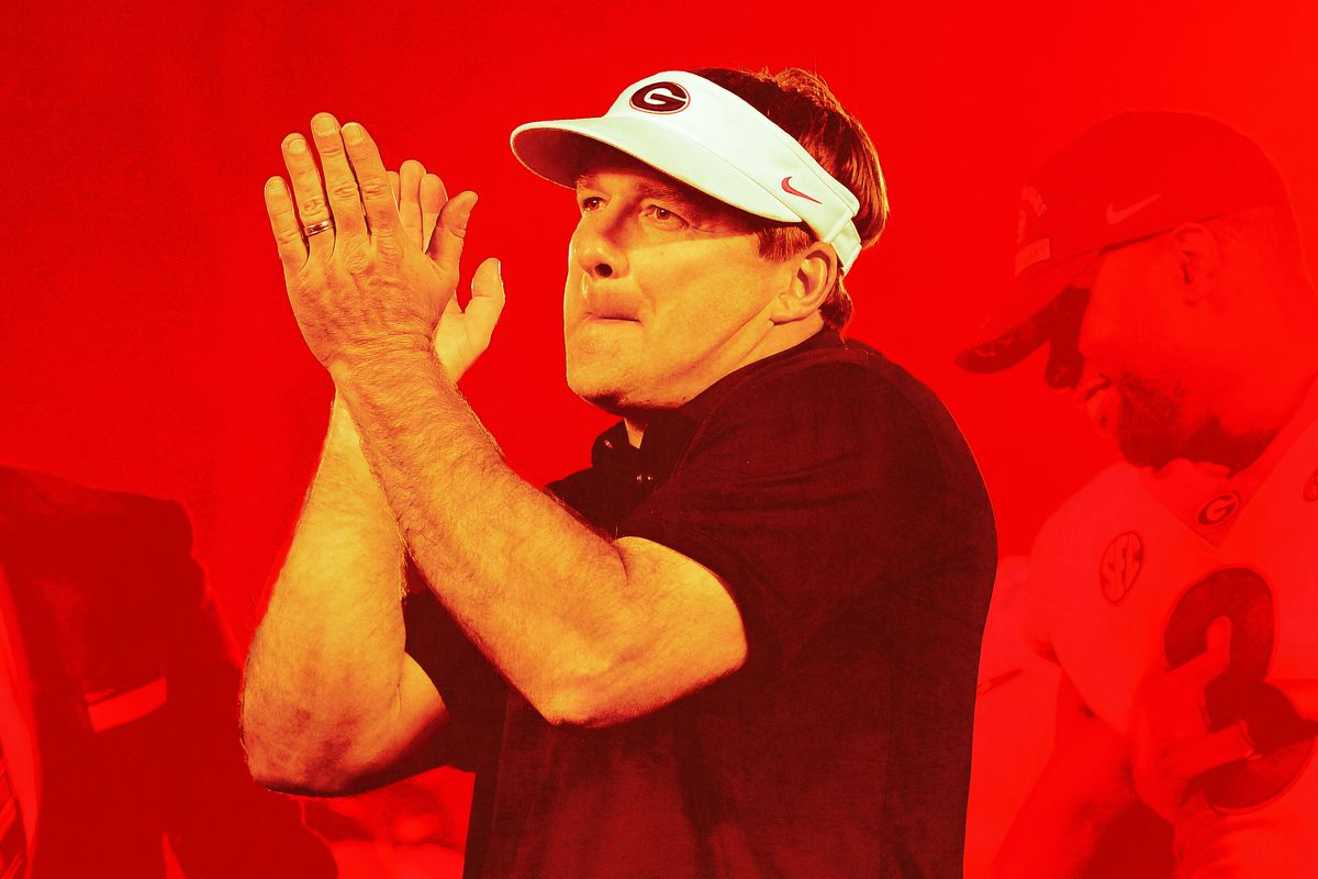 Kirby Smart clapping and wearing a visor
