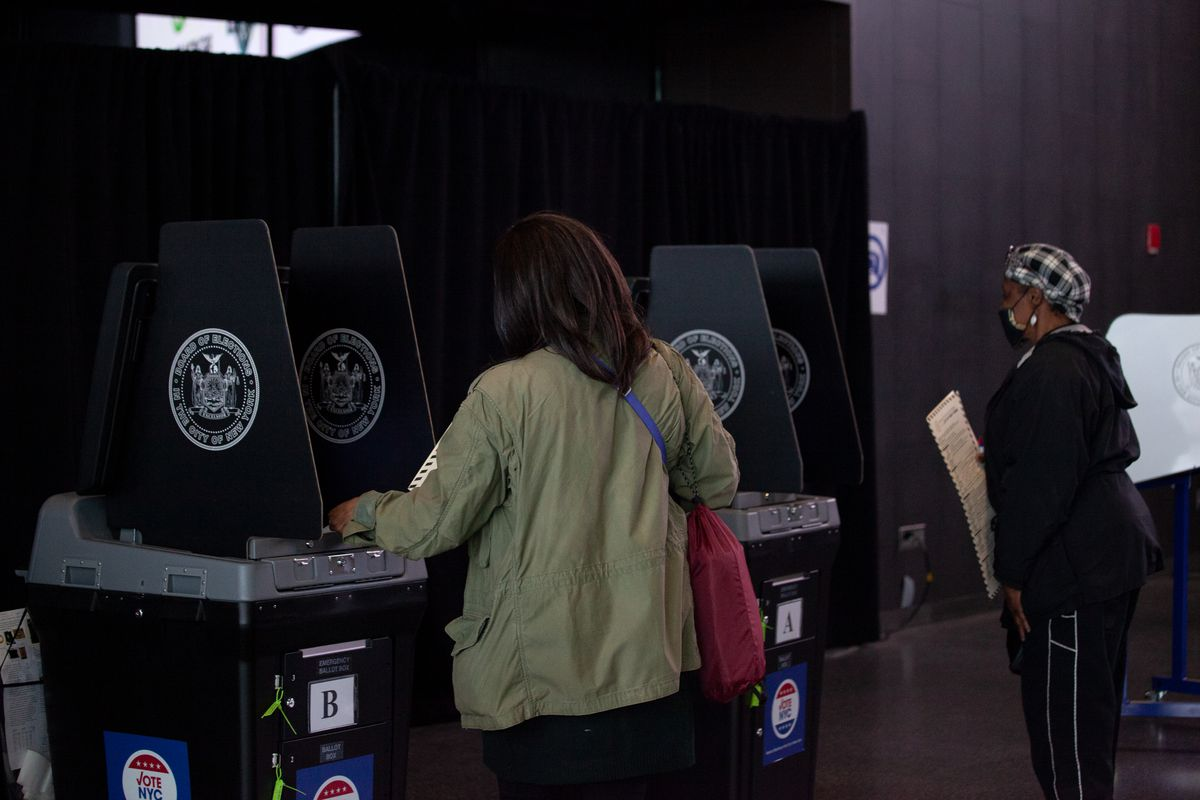 People vote early at the Barclays Center in Brooklyn during the presidential election, Oct. 24, 2020.