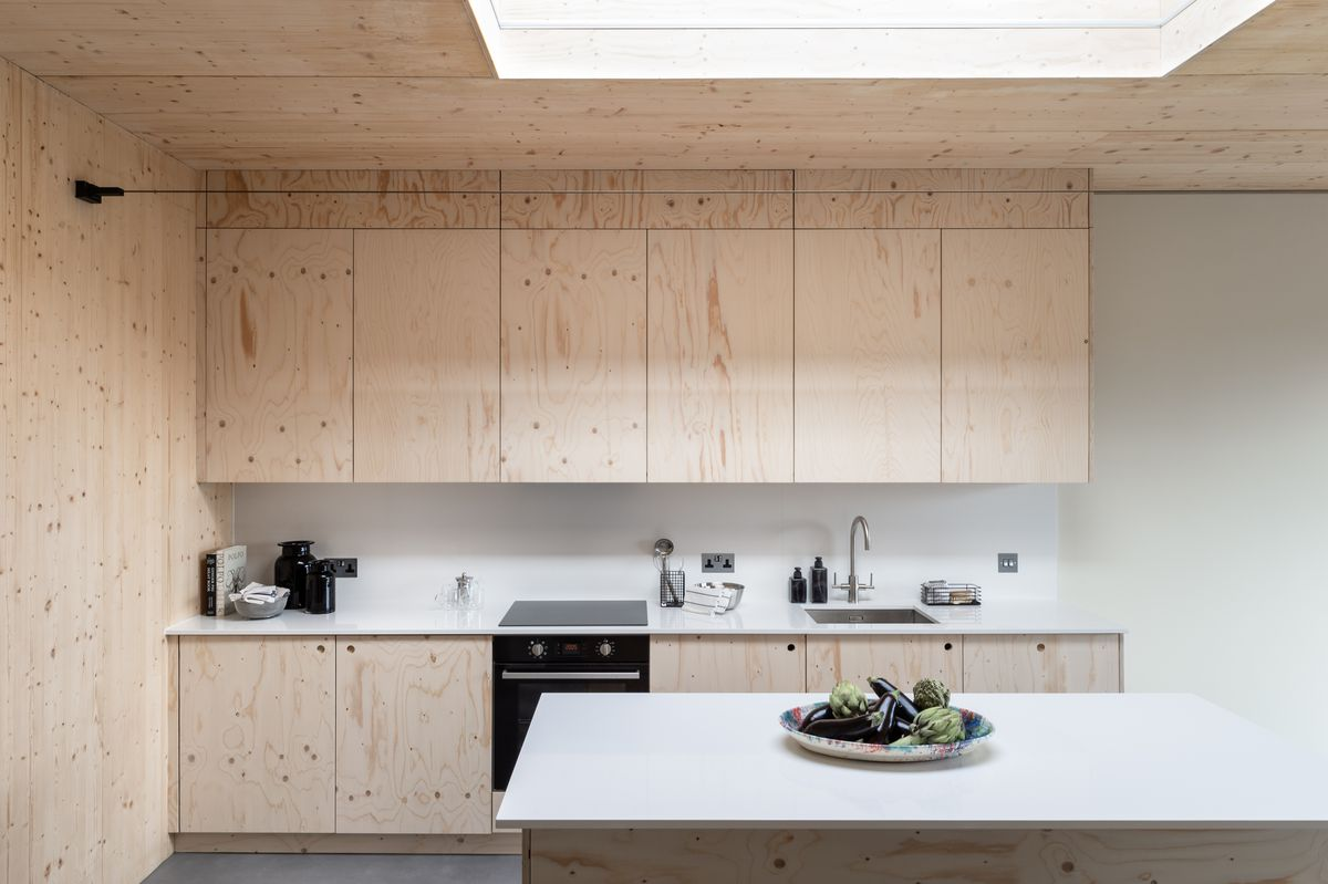 Kitchen with pale wood cabinets.