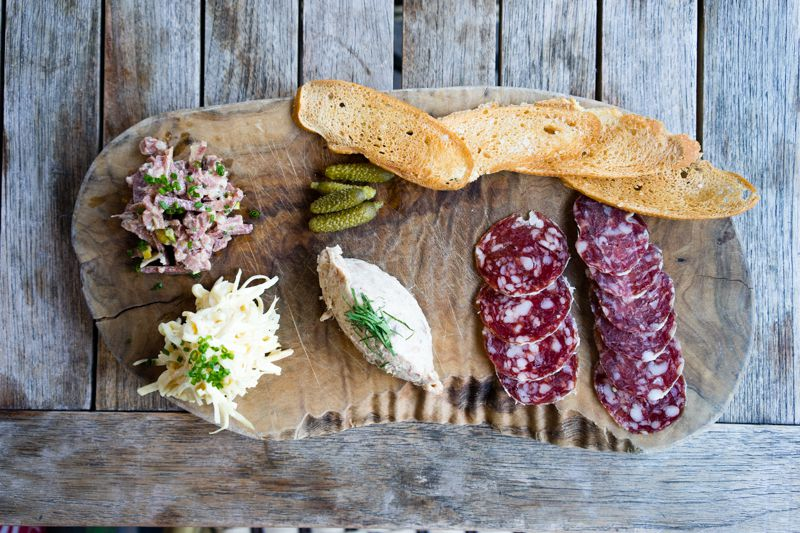 Salami and remoulade on a wooden board at Provender