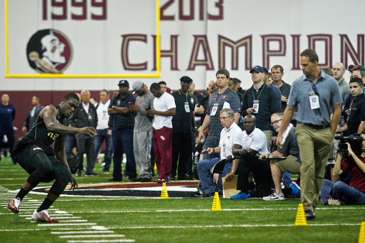 NFL scouts, front office members and coaches watch Florida State Seminoles RB Karlos Williams work out during his pro day, Mar. 31, 2015.