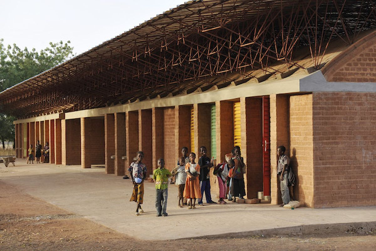 The Gando Primary School (2001) in Burkina Faso by Diébédo Francis Kéré. The clay-brick construction was deliberately designed to engage neighbors in the construction process. All images courtesy Louisiana Museum.