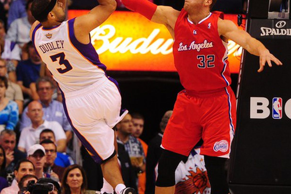 Apr. 19, 2012; Phoenix, AZ, USA; Los Angeles Clippers forward (32) Blake Griffin defends Phoenix Suns forward (3) Jared Dudley as he takes a shot in the first quarter at the US Airways Center. Mandatory Credit: Mark J. Rebilas-US PRESSWIRE