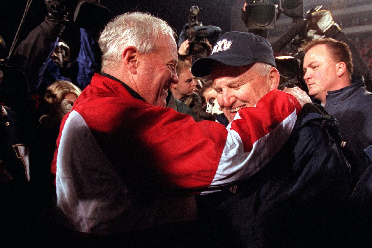 BYU coach LaVell Edwards is congratulated by Utah coach Ron McBride after BYU's 34-27 win in 2000. The legendary figures were two of the the Mountain West Conference football coaches when the league originally began play in 1999.