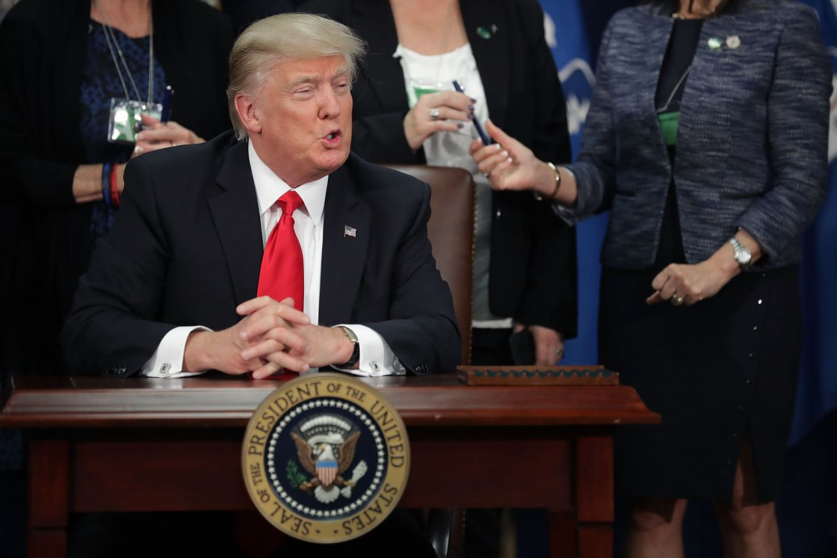 U.S. President Donald Trump makes brief remarks after signing four executive orders during a visit to the Department of Homeland Security January 25, 2017 in Washington, DC.