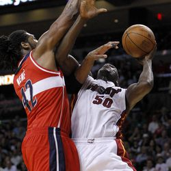 Washington Wizards' Nene (42) prepares to block a shot by Miami Heat's Joel Anthony (50) in the first half of an NBA basketball game in Miami, Saturday, April 21, 2012.