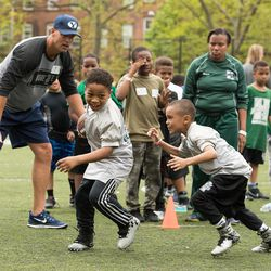 BYU assistant head coach Ed Lamb works with Harlem youth during a clinic staged in New York last weekend.