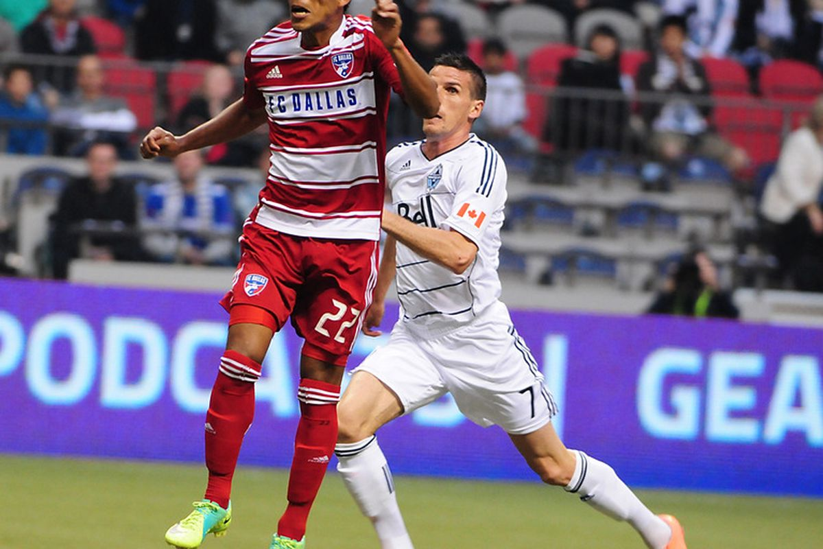 Apr 21, 2012; Vancouver, BC, CANADA; FC Dallas defenseman Carlos Rodriguez (22) heads the ball against Vancouver Whitecaps foward Sebastien Le Toux (7) during the first half at BC Place Stadium.  Mandatory Credit: Anne-Marie Sorvin-US PRESSWIRE