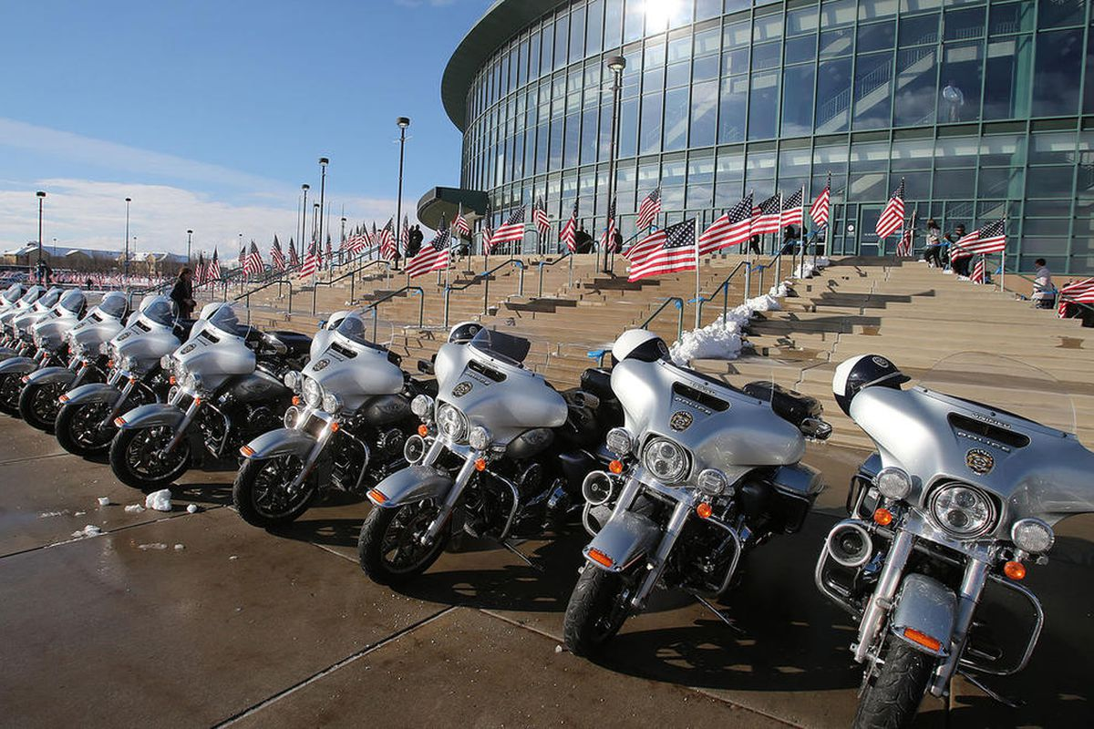 FILE - Motorcycles and flags as people arrive at the funeral of Officer Doug Barney, who was killed in the line of duty, arrives at the Maverik Center Monday, Jan. 25, 2016, in West Valley City. A motorcycle ride to honor Barney is scheduled for Sunday, M