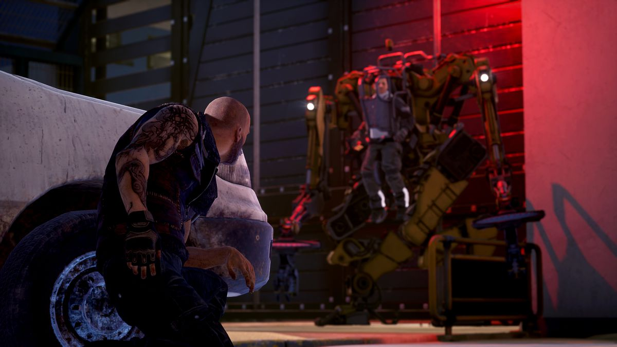 A bald, muscular, tattooed man crouches by a car, observing a smaller man inside a large mecha skeleton