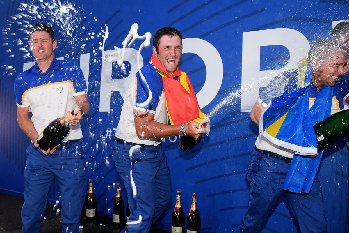 Justin Rose and Jon Rahm of Europe celebrate after winning The Ryder Cup during singles matches of the 2018 Ryder Cup at Le Golf National on September 30, 2018 in Paris, France.